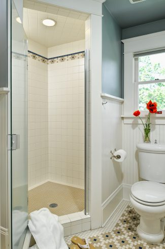 spacious corner shower design by Deb Kadas